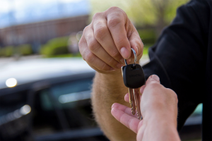 Image of man handing keys to another person