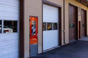 Exterior of Woldfords Paint Bays in Logan UT showing doors